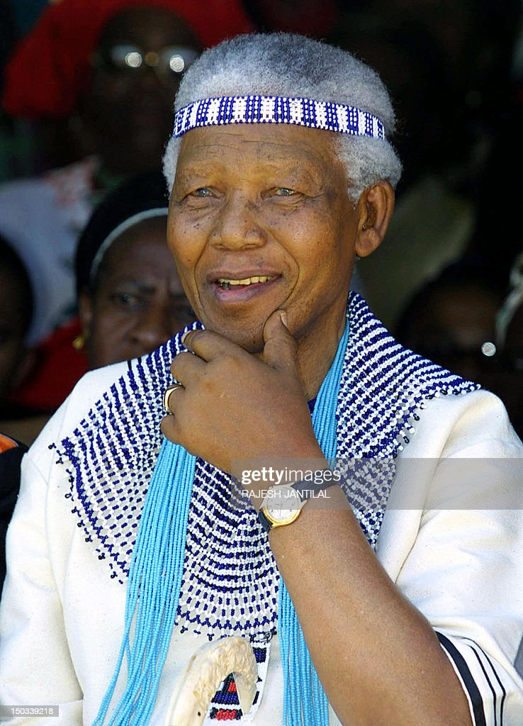 Former South African President Nelson Mandela, wearing traditional Xhosa dress as a member of the Tembu Royal family, attends the wedding of his great grand nephew, Prince Mfundo Mtirarar, 07 December 2002 in Umtata, Eastern Cape Province.