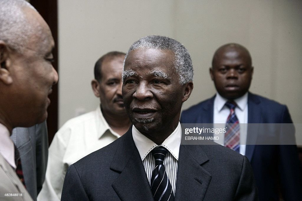 Former South African President <a gi-track='captionPersonalityLinkClicked' href=/galleries/search?phrase=Thabo+Mbeki&family=editorial&specificpeople=160910 ng-click='$event.stopPropagation()'>Thabo Mbeki</a> (C) arrives for a meeting with Sudanese President Omar al-Bashir at the Presidential palace in Khartoum on August 3, 2015.