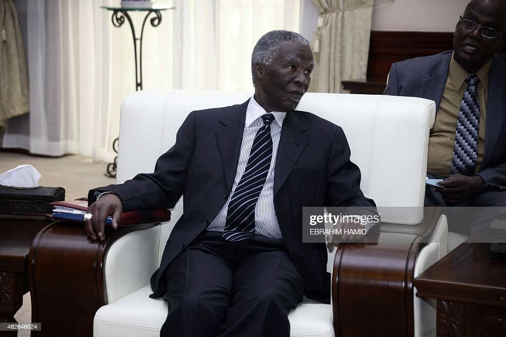 Former South African President <a gi-track='captionPersonalityLinkClicked' href=/galleries/search?phrase=Thabo+Mbeki&family=editorial&specificpeople=160910 ng-click='$event.stopPropagation()'>Thabo Mbeki</a> meets with Sudanese President Omar al-Bashir (unseen) at the Presidential palace in Khartoum on August 3, 2015.