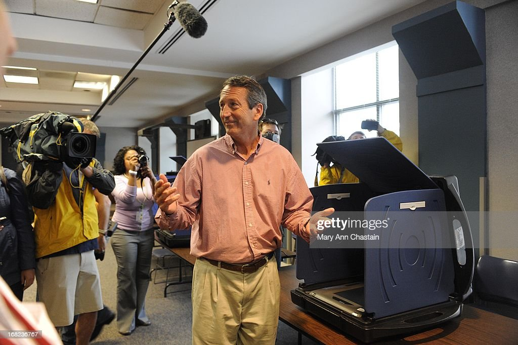Former South Carolina Gov. Mark Sanford throws up his arms after casting his vote in the special election runoff with Elizabeth Colbert Busch for a seat in the 1st Congressional District May 7, 2013 in Charleston, South Carolina. Voters are deciding between Sanford, a Republican seeking a political comeback after an extramarital affair and Busch, a Democratic businesswoman and the sister of comedian of Stephen Colbert.