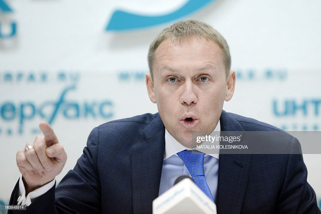 Former Soviet KGB agent and current Russian parliamentarian Andrei Lugovoi gestures while speaking at a press conference in Moscow, on March 12, 2013. Lugovoi is Britain's main suspect in the 2006 polonium poisoning in London of Kremlin critic Alexander Litvinenko. AFP PHOTO / NATALIA KOLESNIKOVA