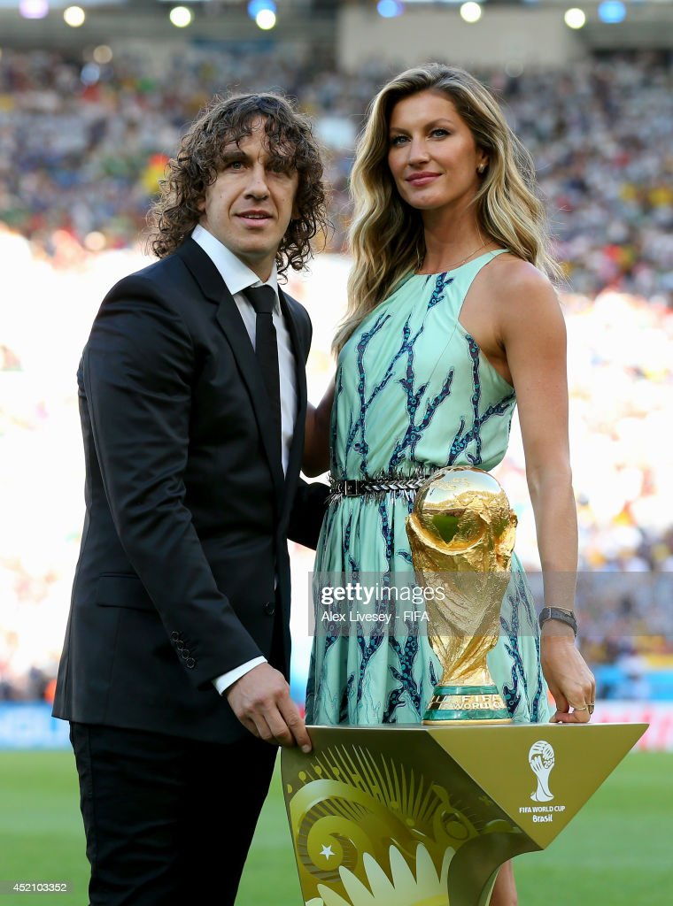Former Spanish international Carles Puyol (L) and model Gisele Bundchen (R) present the World Cup from a Louis Vuitton travel case prior to the 2014 FIFA World Cup Brazil Final match between Germany and Argentina at Maracana on July 13, 2014 in Rio de Janeiro, Brazil.