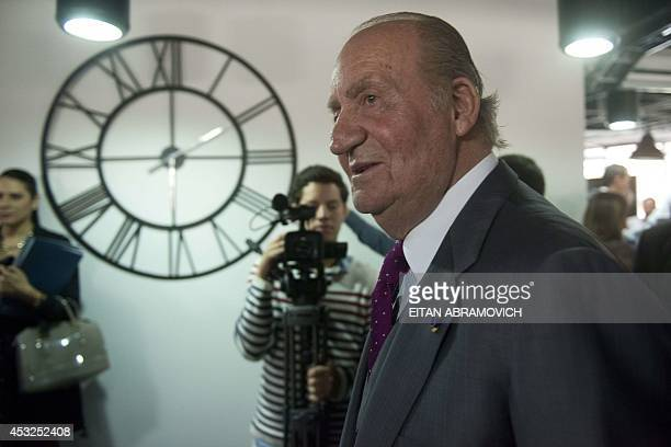 Former Spanish King Juan Carlos I of Spain leaves at the end of his visit to a Spanish company in Bogota on August 6 2014 in the framework of his...