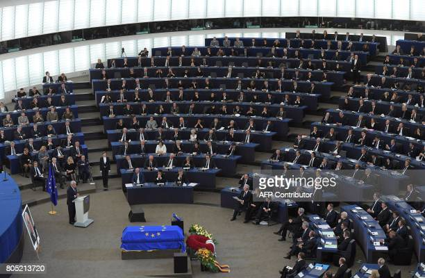 Former Spanish Prime Minister Felipe Gonzalez delivers a speech in front of former US President Bill Clinton German Chancellor Angela Merkel French...