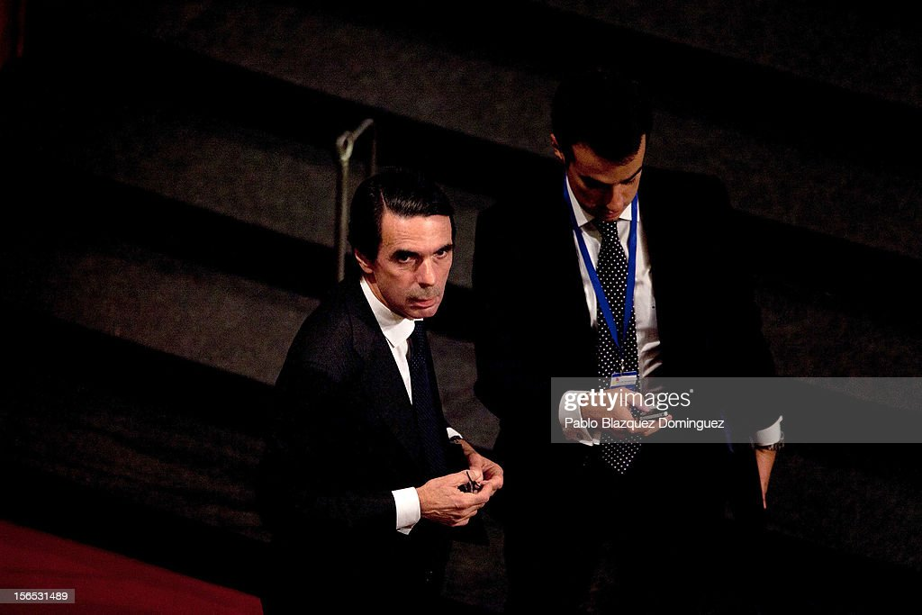 Former Spanish Prime Minister <a gi-track='captionPersonalityLinkClicked' href=/galleries/search?phrase=Jose+Maria+Aznar&family=editorial&specificpeople=208947 ng-click='$event.stopPropagation()'>Jose Maria Aznar</a> (L) attends the opening ceremony of the the XXII Ibero-American Summit at Falla Theatre on November 16, 2012 in Cadiz, Spain. The 22nd Ibero-American Summit is Mariano Rajoy's first as President of Spain and will be attended by 16 Foreign Affairs ministers. The main issues of the meeting will be the economic crisis and how Latin American countries can contribute to the Eurozone recovery.