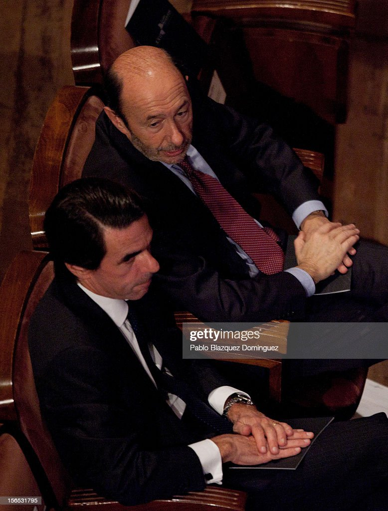 Former Spanish Prime Minister <a gi-track='captionPersonalityLinkClicked' href=/galleries/search?phrase=Jose+Maria+Aznar&family=editorial&specificpeople=208947 ng-click='$event.stopPropagation()'>Jose Maria Aznar</a> (bottom) chats with Spain's leader of the opposition Socialist Party (PSOE) <a gi-track='captionPersonalityLinkClicked' href=/galleries/search?phrase=Alfredo+Perez+Rubalcaba&family=editorial&specificpeople=692536 ng-click='$event.stopPropagation()'>Alfredo Perez Rubalcaba</a> (top) during the opening ceremony of the the XXII Ibero-American Summit at Falla Theatre on November 16, 2012 in Cadiz, Spain. The 22nd Ibero-American Summit is Mariano Rajoy's first as President of Spain and will be attended by 16 Foreign Affairs ministers. The main issues of the meeting will be the economic crisis and how Latin American countries can contribute to the Eurozone recovery.
