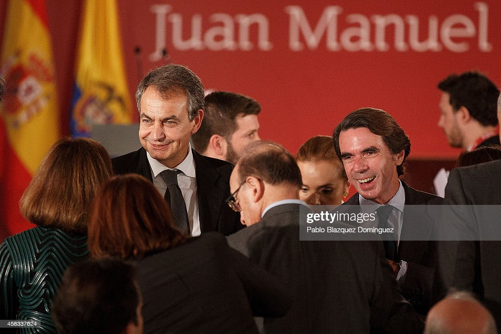 Former Spanish Prime Ministers Jose Luis Rodriguez Zapatero (L) and Jose Maria Aznar (R) attend a ceremony where Colombia's President Juan Manuel Santos receives an Honorary Doctorate at the Camilo Jose Cela university on November 3, 2014 in Villafranca del Castillo, just outside Madrid, Spain. Juan Manuel Santos is on an official visit to Spain which will follow with visits to other European cities.