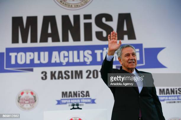 Former Speaker of the Turkish Grand National Assembly Bulent Arinc greets citizens as he attends the mass opening ceremony at the Republic Square in...