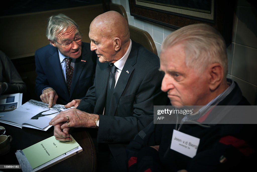Former speedskaters (L-R) Reinier Paping, Jan Uitham and Jeen van de Berg chat during the reunion of the participants of the Elfstedentocht (Eleven cities tour) of 1963, in Hindeloopen, on January 18, 13. The race took place 50 years ago under heavy weather conditions. AFP PHOTO/ANP/ATRINUS VAN DER VEEN netherlands out