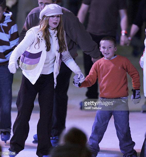 Former Spice Girl Geri Halliwell and Brooklyn Beckham the son of Victoria and David Beckham skate together at the Natural History Museum Ice Rink on...