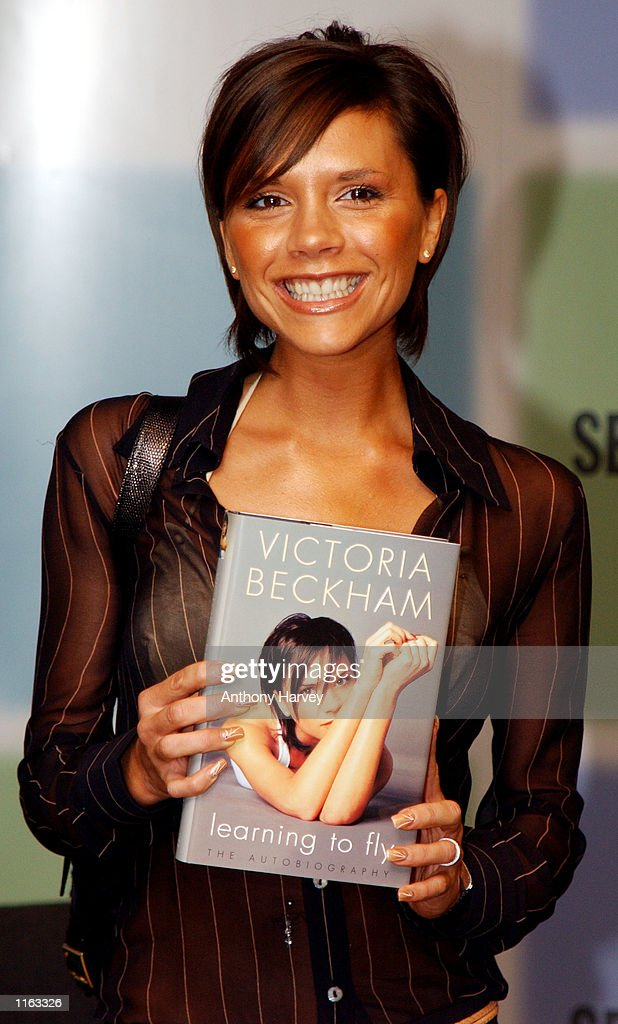 Former Spice Girl Victoria Beckham poses for photographers September 17, 2001 during a signing session to launch her autobiography 'Learning to Fly' at a department store in London.