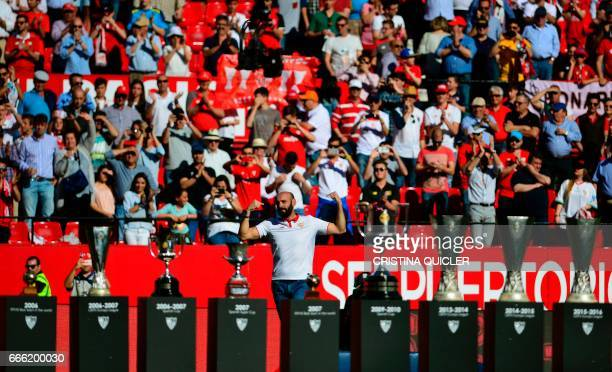 Former sporting director of Sevilla Ramon Rodriguez Berdejo 'Monchi' bids goodbye to club supporters next to the team's trophies before the Spanish...