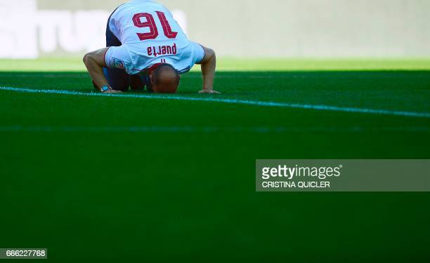 Former sports director of FC Sevilla Ramon Rodriguez Berdejo 'Monchi' kisses the field during his farewell before the Spanish league football match...