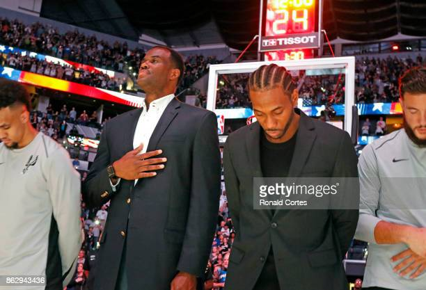 Former Spurs David Robinson joins injured Kawhi Leonard of the San Antonio Spurs during the national anthem before the game against the Minnesota...