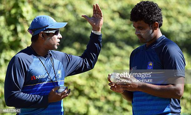 Former Sri Lanka fast bowler and current bowling coach Chaminda Vaas speaks to Thisara Perera during a training session at the Bellerive Oval ground...