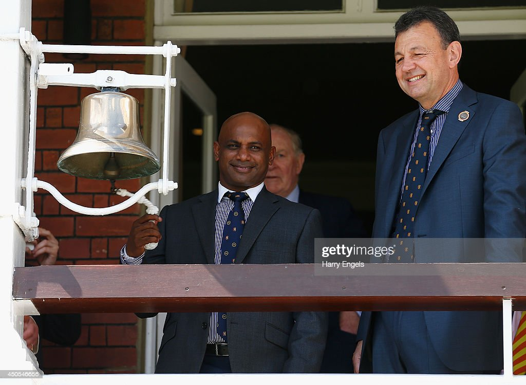 Former Sri Lankan cricketer Sanath Jayasuriya rings the bell beside MCC chief executive Derek Brewer before the start of play on day two of the 1st...