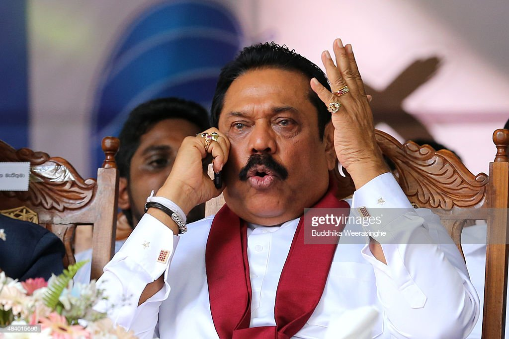 Former Sri Lankan president and parliamentary candidate <a gi-track='captionPersonalityLinkClicked' href=/galleries/search?phrase=Mahinda+Rajapaksa&family=editorial&specificpeople=588377 ng-click='$event.stopPropagation()'>Mahinda Rajapaksa</a> talks on phone during his party's rally on the final day of election campaign on August 14, 2015 in Kandy, Sri Lanka. Sri Lanka's Election Commission has scheduled the polls on August 17, 2015, after Sri Lankan President Maithripala Sirisena has dissolved the parliament on June 26, 2015.