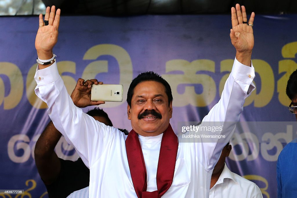 Former Sri Lankan president and parliamentary candidate <a gi-track='captionPersonalityLinkClicked' href=/galleries/search?phrase=Mahinda+Rajapaksa&family=editorial&specificpeople=588377 ng-click='$event.stopPropagation()'>Mahinda Rajapaksa</a> waves to supporters during his party's final day of election campaign rally on August 14, 2015 in Kandy, Sri Lanka. Sri Lanka's Election Commission has scheduled the polls on August 17, 2015, after Sri Lankan President Maithripala Sirisena dissolved the parliament on June 26, 2015.