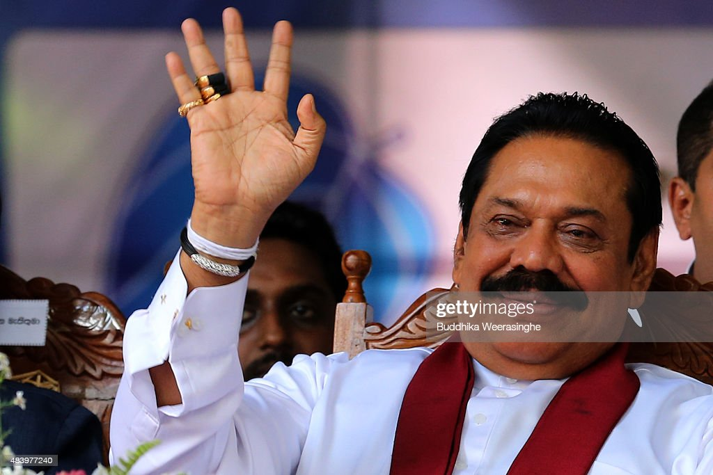 Former Sri Lankan president and parliamentary candidate <a gi-track='captionPersonalityLinkClicked' href=/galleries/search?phrase=Mahinda+Rajapaksa&family=editorial&specificpeople=588377 ng-click='$event.stopPropagation()'>Mahinda Rajapaksa</a> waves to supporters during his partyfs final day of election campaign rally on August 14, 2015 in Kandy, Sri Lanka. Sri Lanka's Election Commission has scheduled the polls on August 17, 2015, after Sri Lankan President Maithripala Sirisena dissolved the parliament on June 26, 2015.