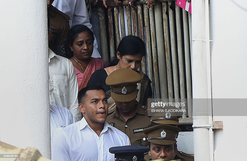 Former Sri Lankan president Mahinda Rajapakse's second son Yoshitha Rajapakse (front L) is taken away to further remand after a magistrate in the Colombo suburb of Kaduwela denied him bail on February 11, 2016. Navy officer Yoshitha Rajapakse, 27, was remanded in custody for two weeks after being arrested at the end of January on a charge of money laundering, police and court officials said. AFP PHOTO / Ishara S. KODIKARA / AFP / Ishara S.KODIKARA