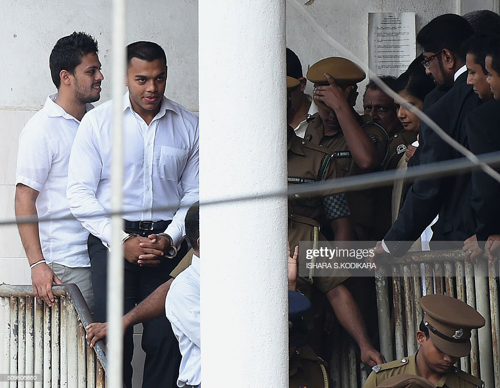 Former Sri Lankan president Mahinda Rajapakse's second son Yoshitha Rajapakse (2nd L) is taken away to further remand after a magistrate in the Colombo suburb of Kaduwela denied him bail on February 11, 2016. Navy officer Yoshitha Rajapakse, 27, was remanded in custody for two weeks after being arrested at the end of January on a charge of money laundering, police and court officials said. AFP PHOTO / Ishara S. KODIKARA / AFP / Ishara S.KODIKARA