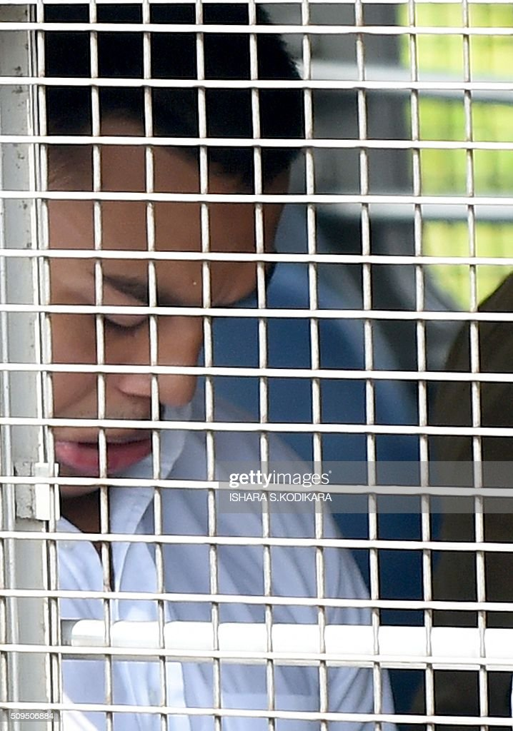 Former Sri Lankan president Mahinda Rajapakse's second son Yoshitha Rajapakse is taken away to further remand after a magistrate in the Colombo suburb of Kaduwela denied him bail on February 11, 2016. Navy officer Yoshitha Rajapakse, 27, was remanded in custody for two weeks after being arrested at the end of January on a charge of money laundering, police and court officials said. AFP PHOTO / Ishara S. KODIKARA / AFP / Ishara S.KODIKARA
