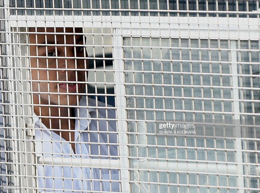 Former Sri Lankan president Mahinda Rajapakse's second son Yoshitha Rajapakse (L) is taken away to further remand after a magistrate in the Colombo suburb of Kaduwela denied him bail on February 11, 2016. Navy officer Yoshitha Rajapakse, 27, was remanded in custody for two weeks after being arrested at the end of January on a charge of money laundering, police and court officials said. AFP PHOTO / Ishara S. KODIKARA / AFP / Ishara S.KODIKARA