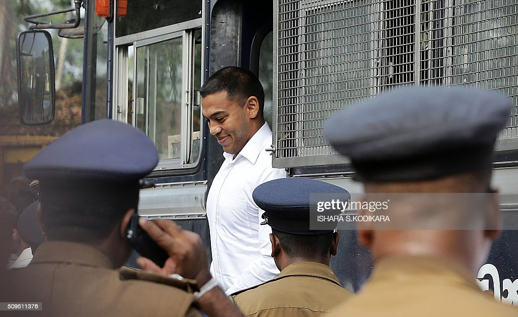 Former Sri Lankan president Mahinda Rajapakse's second son Yoshitha Rajapakse (C) arrives at a court to appear before a magistrate in the Colombo suburb of Kaduwela on February 11, 2016. Navy officer Yoshitha Rajapakse, 27, was remanded in custody for two weeks after being arrested at the end of January on a charge of money laundering, police and court officials said. AFP PHOTO / Ishara S. KODIKARA / AFP / Ishara S.KODIKARA