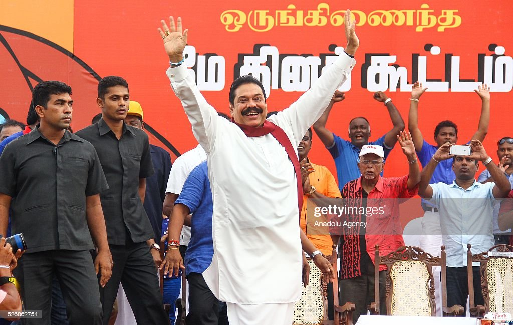 Former Sri Lankan president Mahinda Rajapakse waves as he arrives to attend the May Day rally in Colombo , Sri Lanka, on May 1, 2016