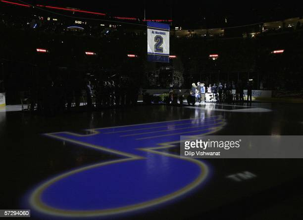 Former St Louis Blues defenseman Al MacInnis and his family watch his banner being raised during his jersey retirement ceremony prior to the game...