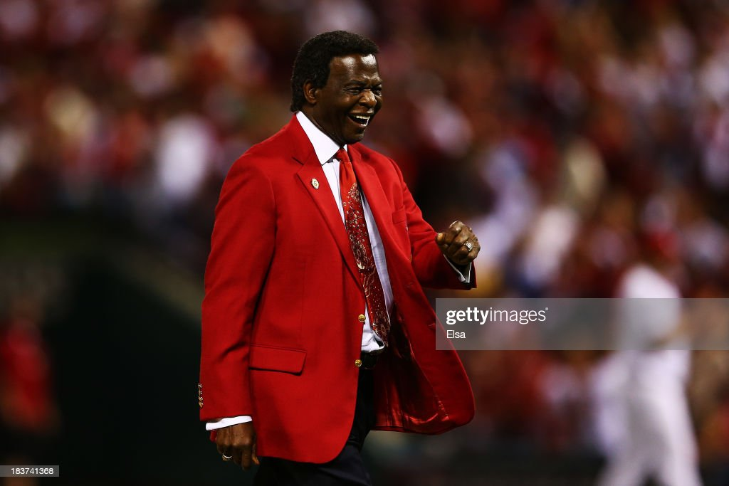 Former St. Louis Cardinal and Hall of Famer <a gi-track='captionPersonalityLinkClicked' href=/galleries/search?phrase=Lou+Brock&family=editorial&specificpeople=207012 ng-click='$event.stopPropagation()'>Lou Brock</a> reacts after throwing out the ceremonial first pitch prior to Game Five of the National League Division Series against the Pittsburgh Pirates at Busch Stadium on October 9, 2013 in St Louis, Missouri.