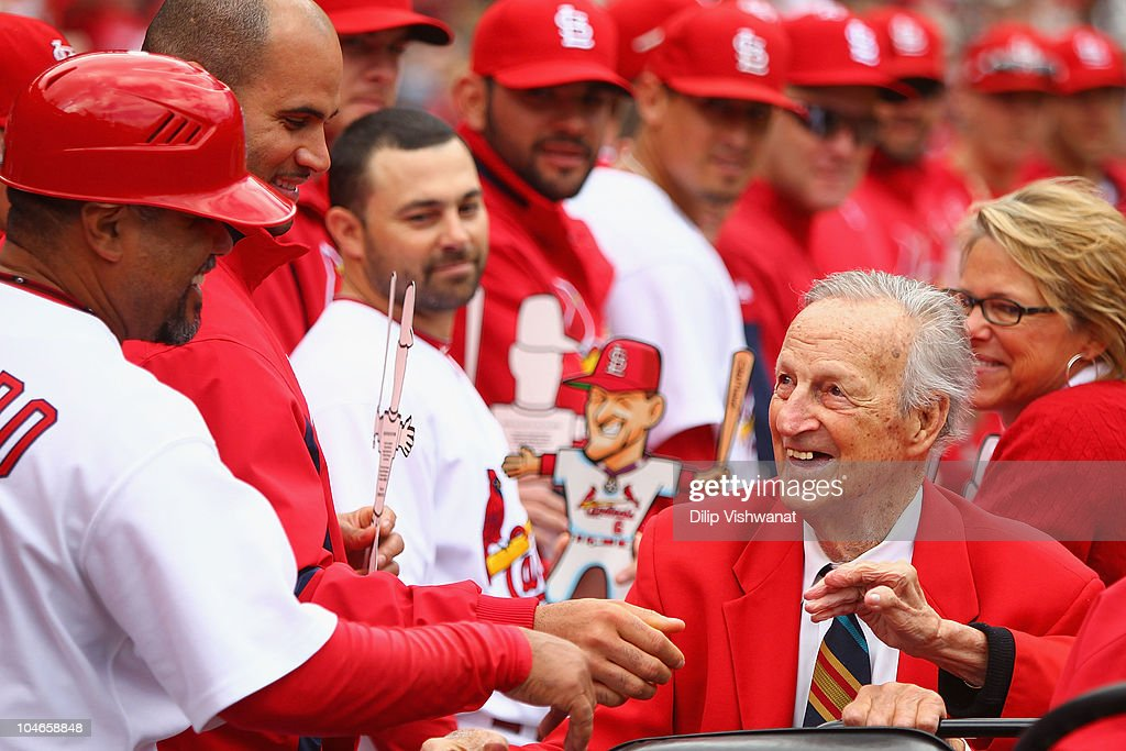 Former St. Louis Cardinals player <a gi-track='captionPersonalityLinkClicked' href=/galleries/search?phrase=Stan+Musial&family=editorial&specificpeople=92694 ng-click='$event.stopPropagation()'>Stan Musial</a> greets members of the St. Louis Cardinals in between innings against the Colorado Rockies at Busch Stadium on October 2, 2010 in St. Louis, Missouri. The Cardinals beat the Rockies 1-0 in 11 innings.