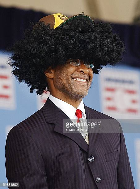 Former St Louis Cardinals shortstop and Baseball Hall of Fame inductee Ozzie Smith wears a wig and a San Diego Padres hat 28 July at the Induction...