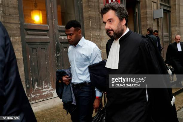 Former Stade Francais' fijian player Josaia Raisuqe flanked by his lawyer Thomas Koltz leaves the courthouse after attending his trial on November 29...