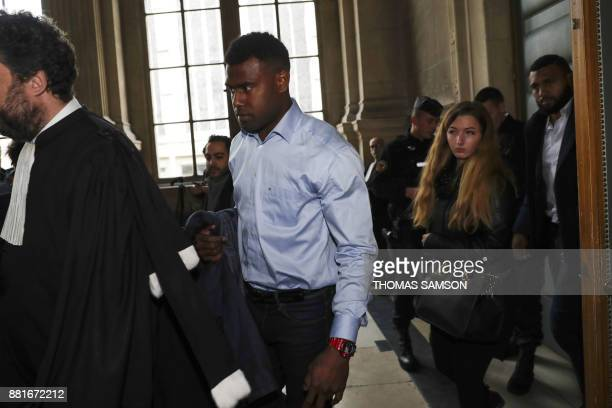 Former Stade Francais' fijian players Josaia Raisuqe and Waisea Nayacalevu leave the courthouse after attending their trial on November 29 2017 at...