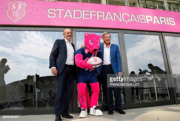 Former Stade Francais Paris president Thomas Savare poses with German billionnaire and new owner of the Stade Francais rugby club HansPeter Wild next...