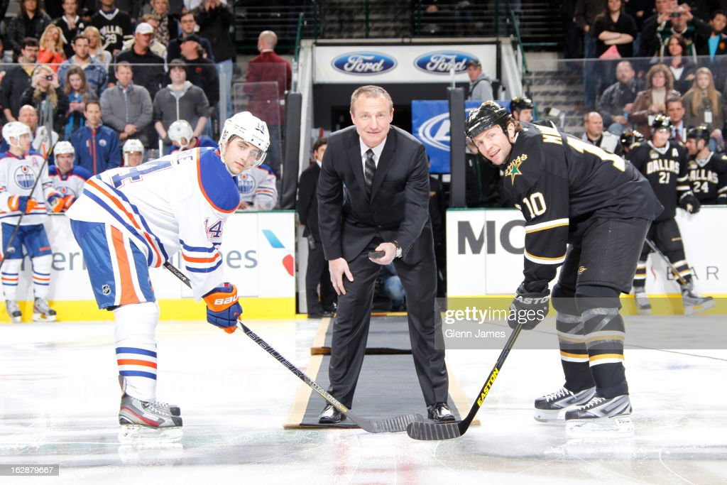 Former Star <a gi-track='captionPersonalityLinkClicked' href=/galleries/search?phrase=Jere+Lehtinen&family=editorial&specificpeople=239506 ng-click='$event.stopPropagation()'>Jere Lehtinen</a> drops the ceremonial puck between <a gi-track='captionPersonalityLinkClicked' href=/galleries/search?phrase=Jordan+Eberle&family=editorial&specificpeople=4898161 ng-click='$event.stopPropagation()'>Jordan Eberle</a> #14 of the Edmonton Oilers and <a gi-track='captionPersonalityLinkClicked' href=/galleries/search?phrase=Brenden+Morrow&family=editorial&specificpeople=202256 ng-click='$event.stopPropagation()'>Brenden Morrow</a> #10 of the Dallas Stars at the American Airlines Center on February 28, 2013 in Dallas, Texas.