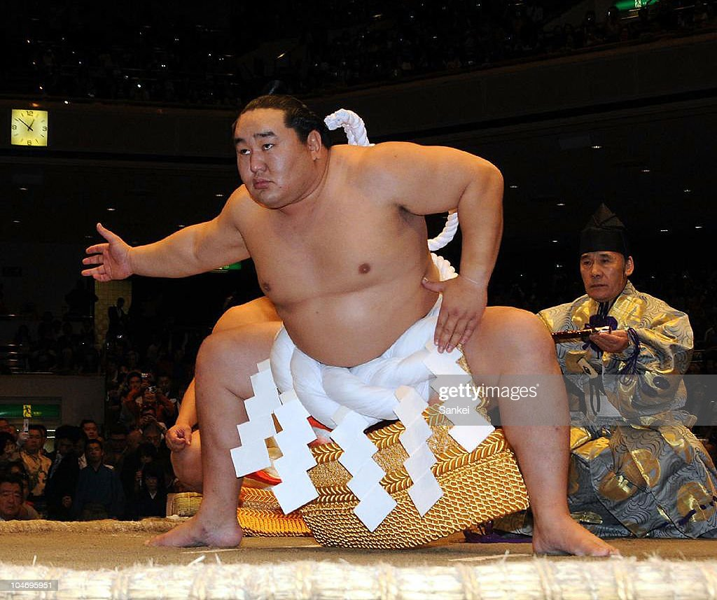 Former Sumo grand champion Asashoryu, real name Dolgorsurengiin Dagvadorj, performs his final 'Dohyo-iri' (ring purification ritual) during his retirement ceremony at Ryogoku Kokugikan on October 3, 2010 in Tokyo, Japan.