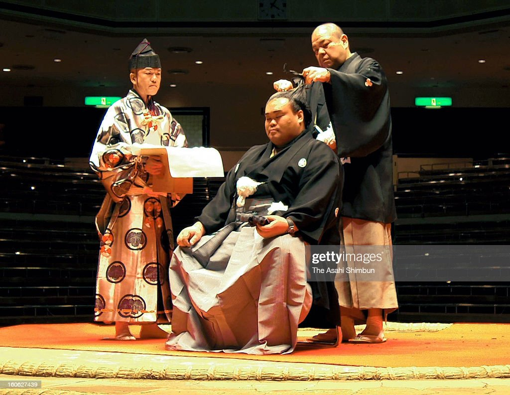 Former sumo wrestler Hokutokuni has his top knot cut by his stable master Hakkaku during his retirement ceremony at Ryogoku Kokugikan on February 2, 2013 in Tokyo, Japan. Hokutokuni, is the only wrestler in more than 225 years history of sumo who repromoted to Sekitori (above Juryo rank) after dropping out of the ranking due to his right wrist operation and unable to compete more than an year.