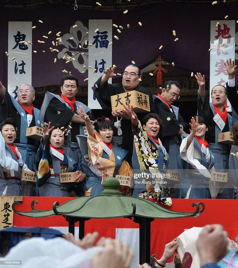 Former sumo wrestler Takamisakari (C), or stable master Furiwake, scatters beans during the 'Setsubun' ceremony at Chusonji Temple on February 3, 2013 in Hiraizumi, Iwate, Japan. The ceremony is held all over Japan on Setsubun, a day before the beginning of spring, on February 3 or 4 according to the Japanese lunar calendar. It has been said that throwing beans drives out misfortune and brings in good luck.