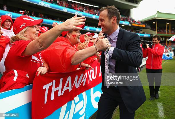 Former Swan Jude Bolton thanks the crowd during a lap of honour before the round four AFL match between the Sydney Swans and the North Melbourne...