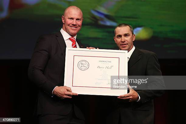 Former Swans player Barry Hall receives his Sydney Swans Hall of Fame Induction from former Swans player Paul Kelly during the Sydney Swans AFL...