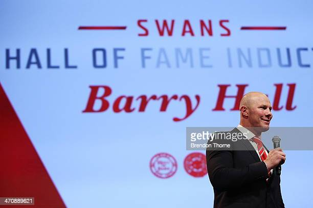 Former Swans player Barry Hall speaks on stage after being inducted into the Sydney Swans Hall of Fame during the Sydney Swans AFL guernsey...