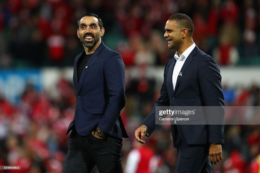 Former Swans players, <a gi-track='captionPersonalityLinkClicked' href=/galleries/search?phrase=Adam+Goodes&family=editorial&specificpeople=206473 ng-click='$event.stopPropagation()'>Adam Goodes</a> and <a gi-track='captionPersonalityLinkClicked' href=/galleries/search?phrase=Michael+O%27Loughlin&family=editorial&specificpeople=215115 ng-click='$event.stopPropagation()'>Michael O'Loughlin</a> enter the field to present the Marn Grook Trophy after the round 10 AFL match between the Sydney Swans and the North Melbourne Kangaroos at Sydney Cricket Ground on May 27, 2016 in Sydney, Australia.