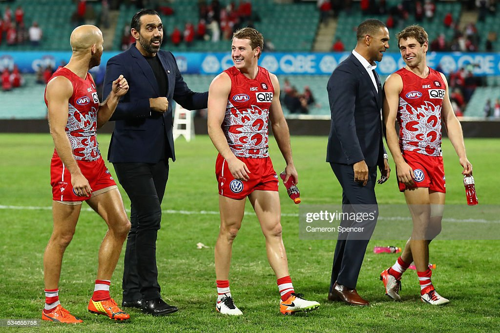 Former Swans players <a gi-track='captionPersonalityLinkClicked' href=/galleries/search?phrase=Adam+Goodes&family=editorial&specificpeople=206473 ng-click='$event.stopPropagation()'>Adam Goodes</a> and <a gi-track='captionPersonalityLinkClicked' href=/galleries/search?phrase=Michael+O%27Loughlin&family=editorial&specificpeople=215115 ng-click='$event.stopPropagation()'>Michael O'Loughlin</a> talk to <a gi-track='captionPersonalityLinkClicked' href=/galleries/search?phrase=Jarrad+McVeigh&family=editorial&specificpeople=3083250 ng-click='$event.stopPropagation()'>Jarrad McVeigh</a>, Harry Cunningham and Nick Smith of the Swans following the round 10 AFL match between the Sydney Swans and the North Melbourne Kangaroos at Sydney Cricket Ground on May 27, 2016 in Sydney, Australia.