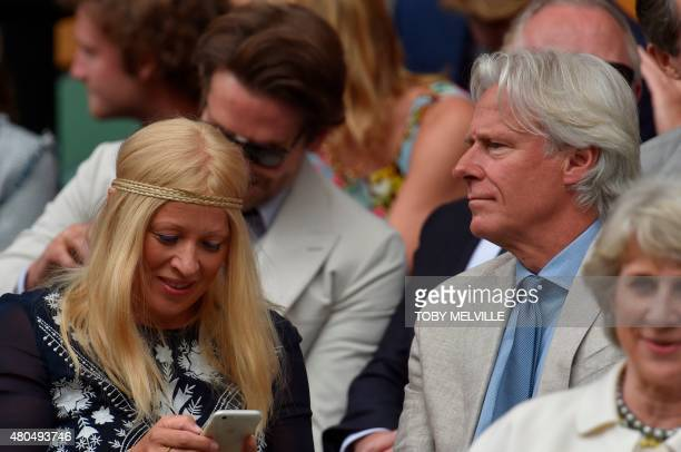 Former Swedish professional tennis player Bjorn Borg and his wife Patricia Ostfeldt sit on Centre Court to watch the men's singles final match...