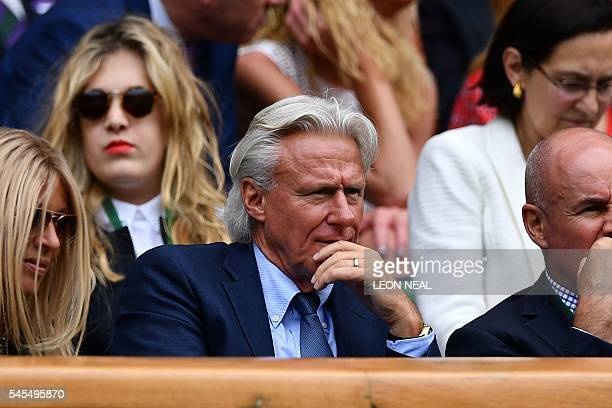 Former Swedish tennis champion Bjorn Borg sits in the royal box on centre court during the men's semifinal match between Switzerland's Roger Federer...