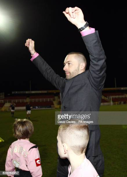 Former Swindon Town player Christian Roberts acknowledges the crowd prior to kick off in the Christian Roberts Testimonial match at the County Ground...