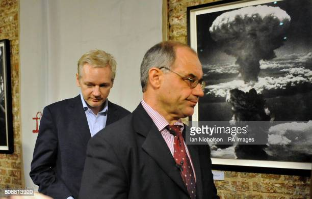 Former Swiss banker and whistleblower Rudolf Elmer arrives at the Frontline Club in London with the WikiLeaks founder Julian Assange prior to handing...
