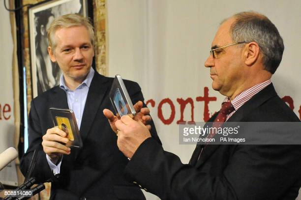 Former Swiss banker and whistleblower Rudolf Elmer hands over two CDs to the WikiLeaks founder Julian Assange which he claims contain information...